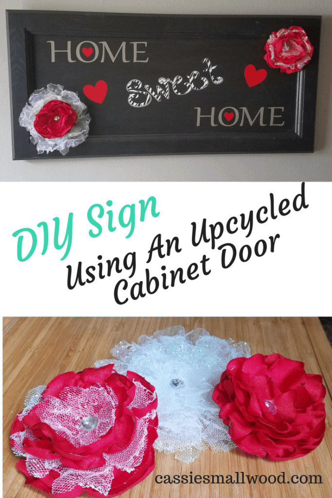 Easy to make DIY sign using an upcycled cabinet door and melted fabric flowers. Use this technique to make your own farmhouse fixer upper style signs.